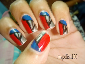 These nails are just perfect and look like decalshttp://mypolish100.blogspot.in/2013/01/prism-nails-tutorial.html