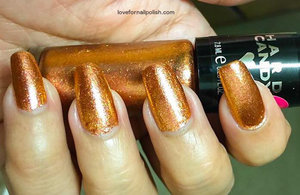 See the review and swatches http://lovefornailpolish.com/hard-candy-nail-polish-walmart-bronze-champion-swatches