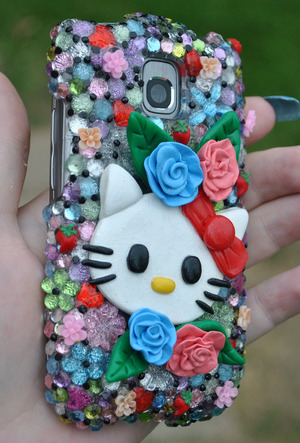 I decorated my phone case..even made the flowers and hello kitty :)