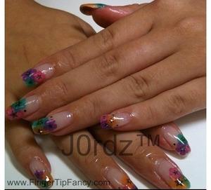http://fingertipfancy.com/multi-color-flower-nails
