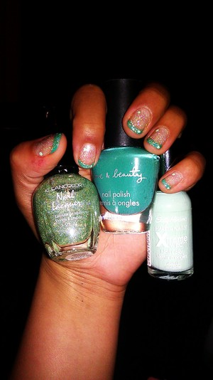 Glitter; klean color nail lacquer in halo green ( got it at a swamp meet ) Tip color; f21s love & beauty polish in jade Two dots; sally hansen xtreme wear in mint sorbet