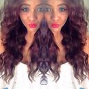 Red lips, wavey frizzy hair