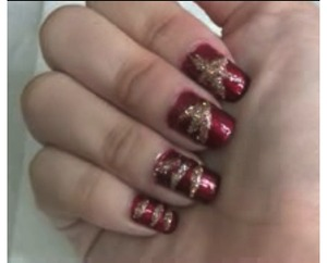 This is my christmas star nail design. the index finger is the star and the others are meant to be the star rays. This was my first time trying this design so my art work isnt perfect.