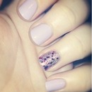 Lilac with purple glitter accent nail.