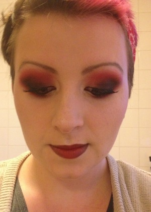 Red, brown and black eyeshadow layered and blended out