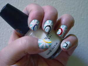 pastel british flag with french tips in Olympic colors complete salon manicure - barracuda (blue) sinful colors - snow me white sinful colors - easy going (pink) sinful colors -  ruby ruby (red) sinful colors -  midnight blue  kiss fine art pen - black  Ulta  - envy (green)  sally hansen insta dry - Lightening