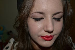 Extreme cat eye with a red lip.