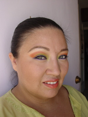 lime green and orange with purple eyeliner...  I tried to used complementary colors..
