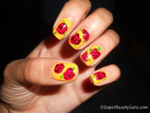 It's almost Spring, so here's a cute and simple red rose nail look in honor of that! Want more? http://superbeautyguru.com/how-to-create-simple-rose-nail-design-on-your-nails/  rose nails, red rose nail look, red rose nail tutorial, vintage, vintage rose nails, roses, Spring, nails, nail look, nail tutorial, nail art, nail design, beauty, red roses, creative nails, nail blog, Amber Johnson, Amber Camille Johnson