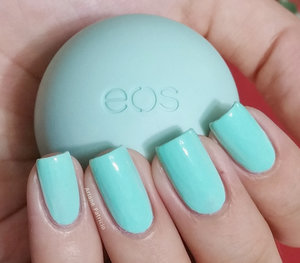 I'm holding an eos smooth sphere in the flavor Sweet Mint and this is also a swatch of Jenna Hipp Freshmaker from the What's Hot Now Nail Collection :)