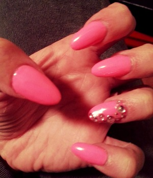 pink polished acrylic nails with clear stones