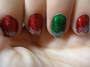 my attempt at christmas nails, way before christmas. red nailpolish is from a walmart makeup set and the green is sally hansen
