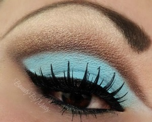 matte neon blue with a shimmery brown cut crease
