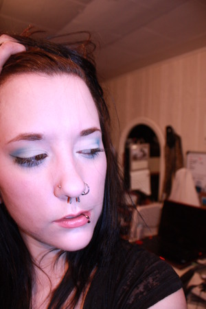 white and blue shadow with simplified liner and pink lipstick