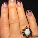 Glitter acrylic nails.