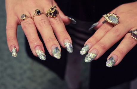 Elena's nails look winter-wonderful with stripes of real glitter in shades of opal, silver, and ice blue.