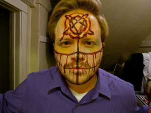 Used toilet paper and liquid latex to create cut of pentagram into forehead