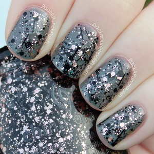 One coat of Razzle Me Dazzle Me over China Glaze Immortal. A mix of very light pink glitter and black glitter.  Glitz Bitz 'N Pieces Collection.  Full Blog Post: http://www.packapunchpolish.com/2013/01/china-glaze-razzle-me-dazzle-me-swatches.html