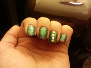 French tip with accent nail... color club ho ho holly with China glaze glitter all the way tips. one coat of fairy dust by China glaze over entire manI with hand placed glitter.
