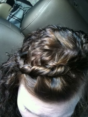 a single cornrow in my bangs. I had lowlights, longer bangs, and lighter hair at one point. I also had a spiral perm too which I still have. and this braid is also known as an inverted braid