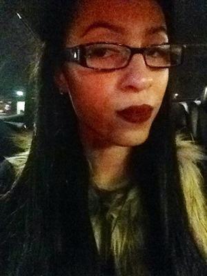 Fur vest, glasses and MAC Diva lipstick.
