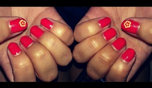 tangerine orange nails with a fimo flower! perfect and simple just for summer!! :)