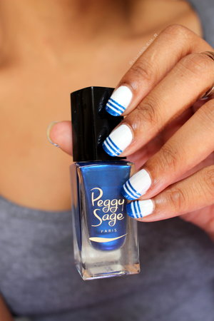 You can find more details on my website http://www.monsieurlili.com ( in the Womanity section ) The blue color is Blue Pop from Peggy Sage