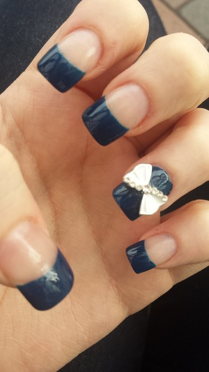 dark shade of  blue with a White and diamonte ring finger bow ??