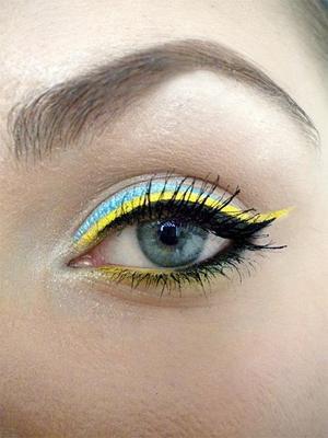 http://missbeautyaddict.blogspot.com/2012/03/sunny-eyes-make-up.html