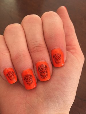 Pigmented gel manicure with sugar skull decals (from YRNAILS).