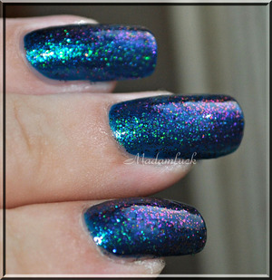 base color is finger paints in the color Artistic Azure and on top is HITS Moonbow(glitter)