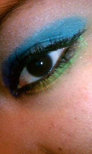 Colorful eyeshadow, Rainbow colors strong with blues and greens. Fun different look