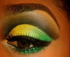 Black Cut crease with yellow and green. NYX Glitter on the Go in Just Green on lower lid with a medium thick winged eyeliner to top it off! :-)