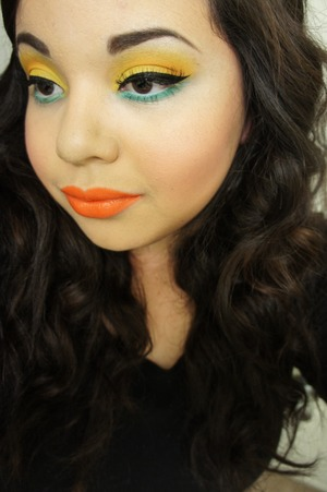 Who says you can't mix a bold eye with a bold lip? ;)
