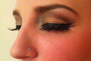 I used seven different eyeshadows, including the one used to line the botton lashes.