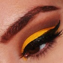 Bright yellow with thick winged liner :)