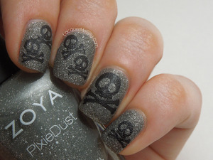 Skull & Crossbone manicure created by stamping over Zoya Pixie Dust texture polish in London. For more information please visit my full blog post: http://www.lacquermesilly.com/2013/07/16/london-crossbones/