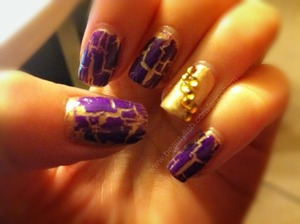 Base coat of gold polish with purple shatter over it